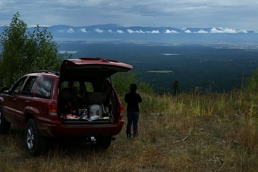 Jeep Grand Cherokee parked on a look look of the Kalispell Mt, valley.