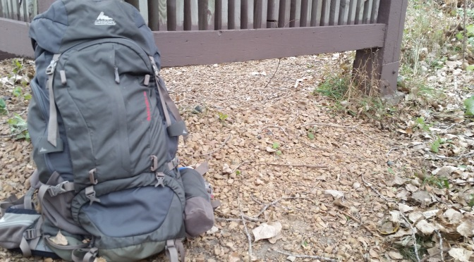 Gregory Backpack leaning on the trailhead sign