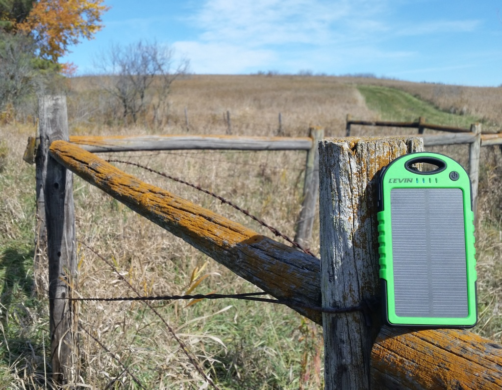 LEVIN Solstar solar charging on fence post overlooking a nature prairie in Minnesota.